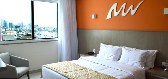 Apartamento standard do hotel, com cama de casal e vista mar