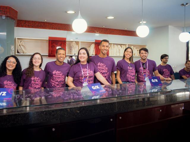 Equipe do credenciamento com toda energia no Hotel Summit